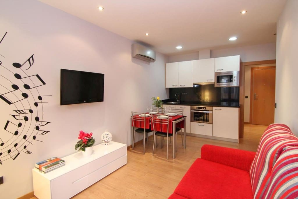 Living room with a kitchen and TV