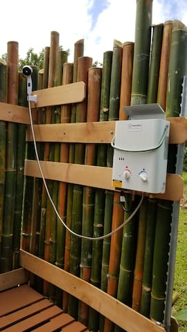 Outdoor shower hand-made of local timber bamboo is a wonderful experience