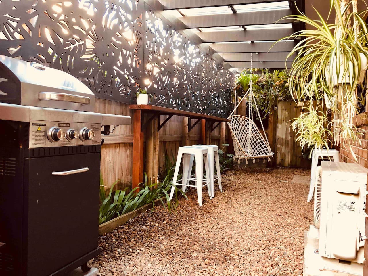 Private fenced courtyard. Bbq, bar seating, swing chair, outdoor shower and clothes line.