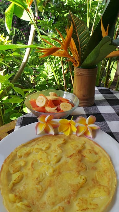 Breakfast by Komang: banana pancake, fresh fruit bowl