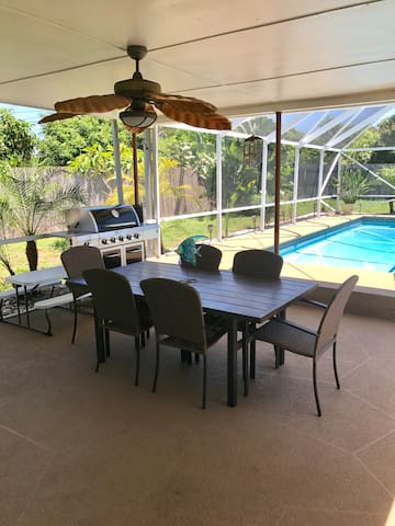 The back patio equipped with a grill and kids picnic table.