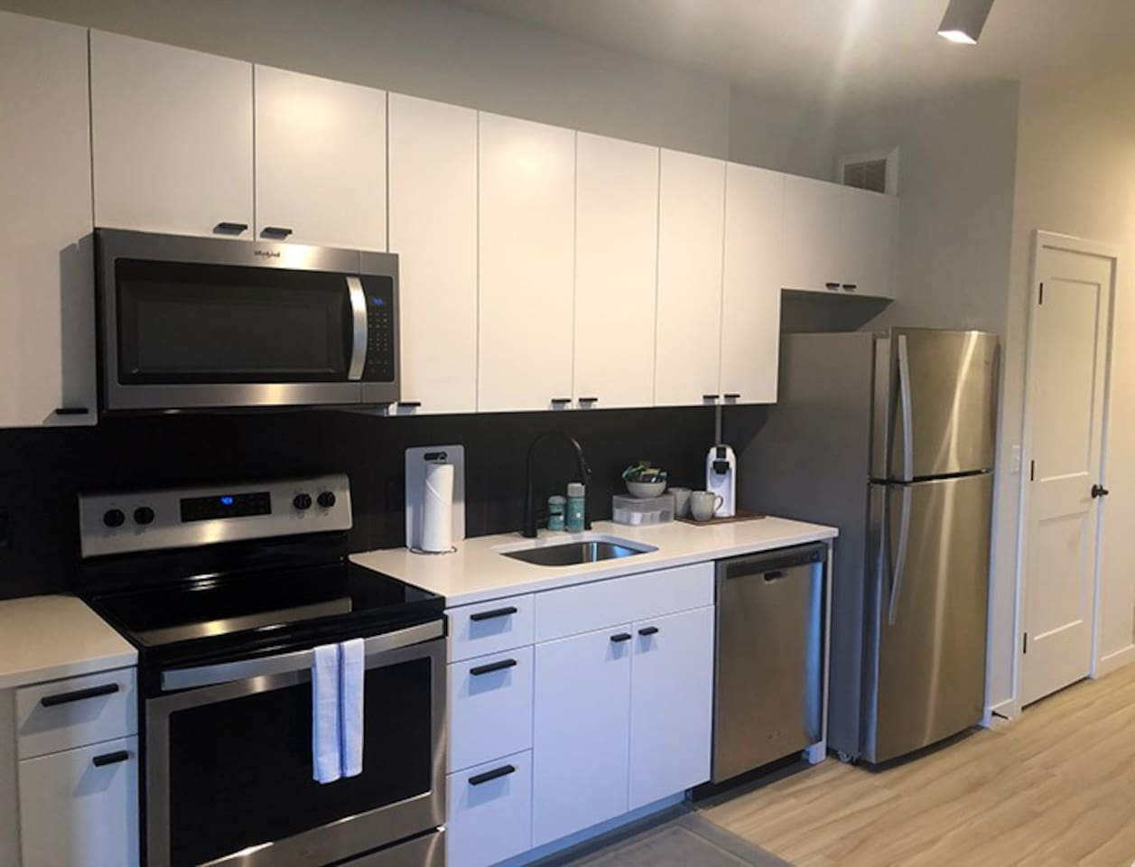 The kitchen is equipped with all of the basics: plates, bowls, mugs, Keurig-like coffee maker, cutlery, a few pots & pans and mixing bowls.