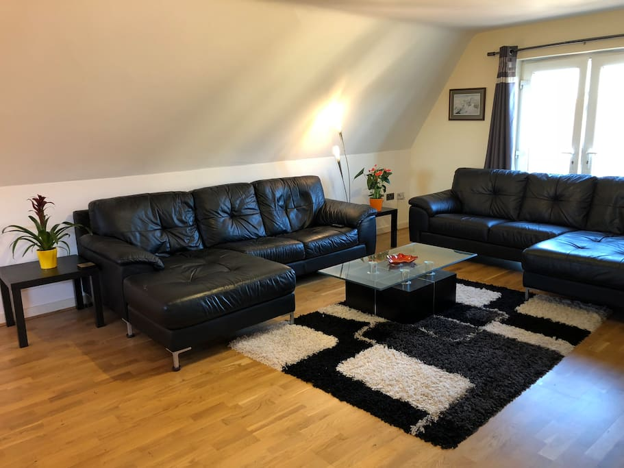 Huge 27ft bright and spacious living room with two large sofas.