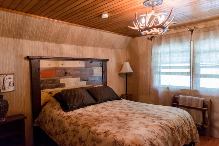 Upstairs queen bedroom with dresser and closet.