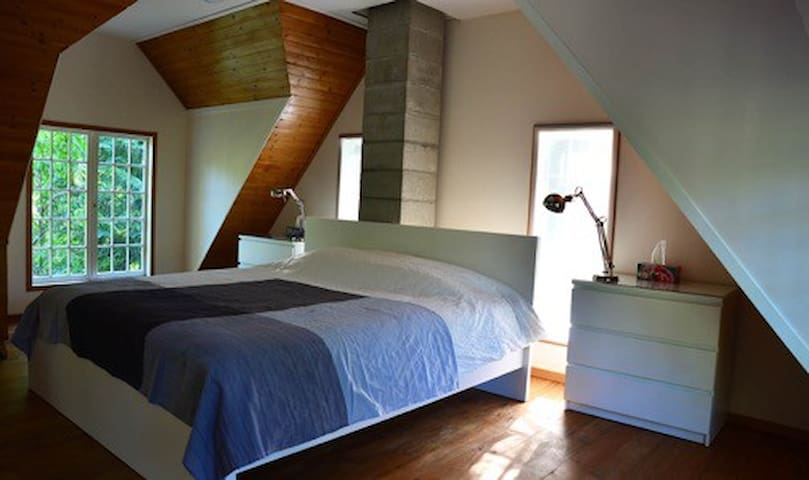 Upstairs King sized bed.