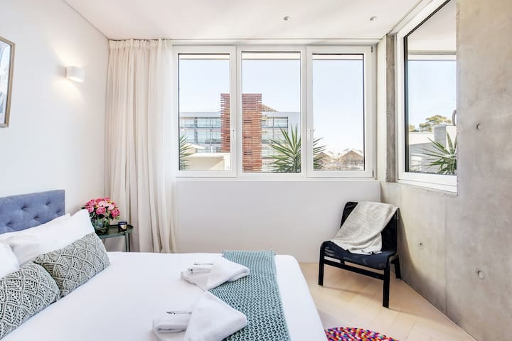 The bedroom features a double bed, ample built-in storage space, and shut-out blinds. With triple-glazed doors and windows throughout, enjoy a good night's sleep in complete peace and quiet.
