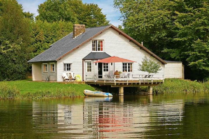 Tastefully house beautifully on a domain on a lake