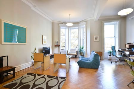 Enjoy the comforts of Park Slope in this newly renovated, tastefully decorated Brownstone apartment. The apartment features giant windows, a deck off of the bedroom, a new kitchen and bathroom as well as all of the comforts you'll need.