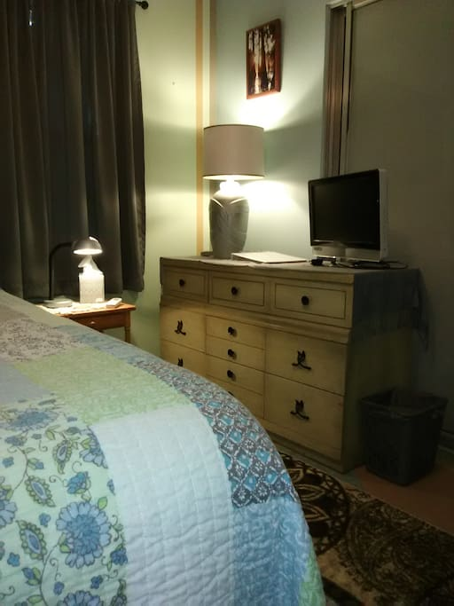 Guest Book with easy access to information for your stay here and enjoying the local are. (maps, menus, brochures, etc.) Monitor, remote and HDMI cable for you to use with your device. The room is private and quiet yet right off the main shared areas.