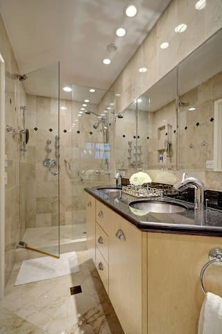 Relaxing Eight-head spa shower in the second master bath