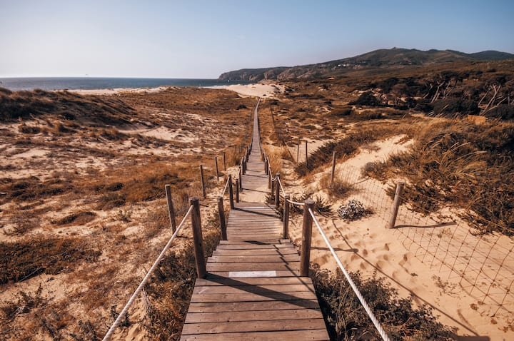 Walking by the charming Guincho Beach