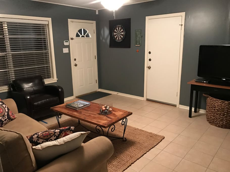 Second living area with TV and dart board.