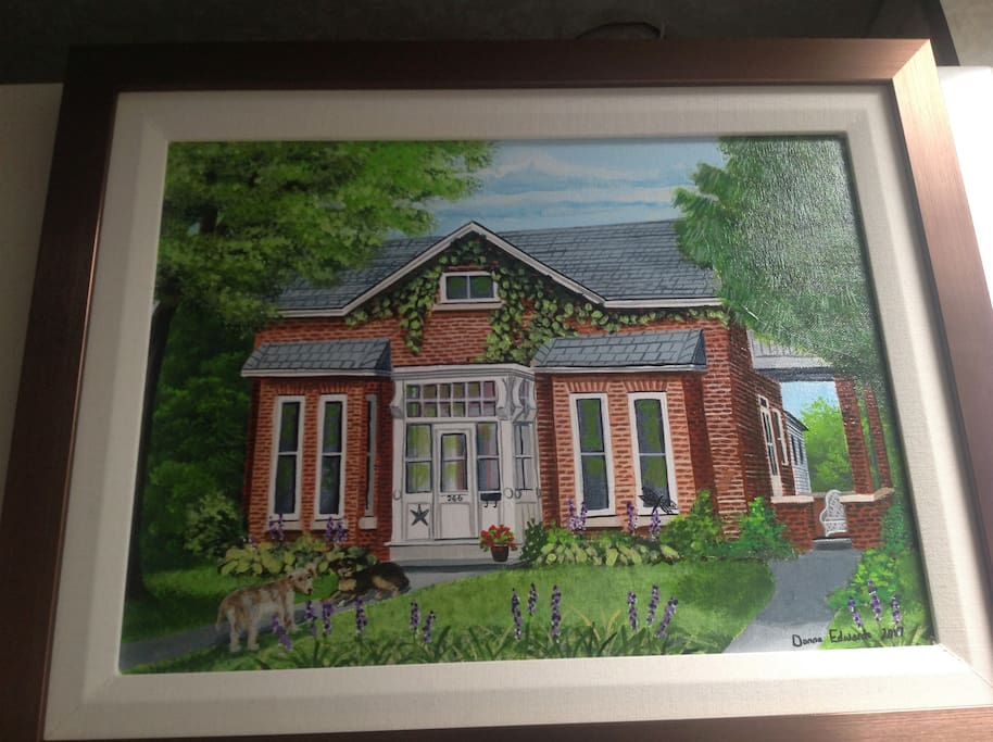 A beautiful painting of my treasured home and the Bicycle Thief on the right with the wicker chair on the porch. My two boys on the front walkway.