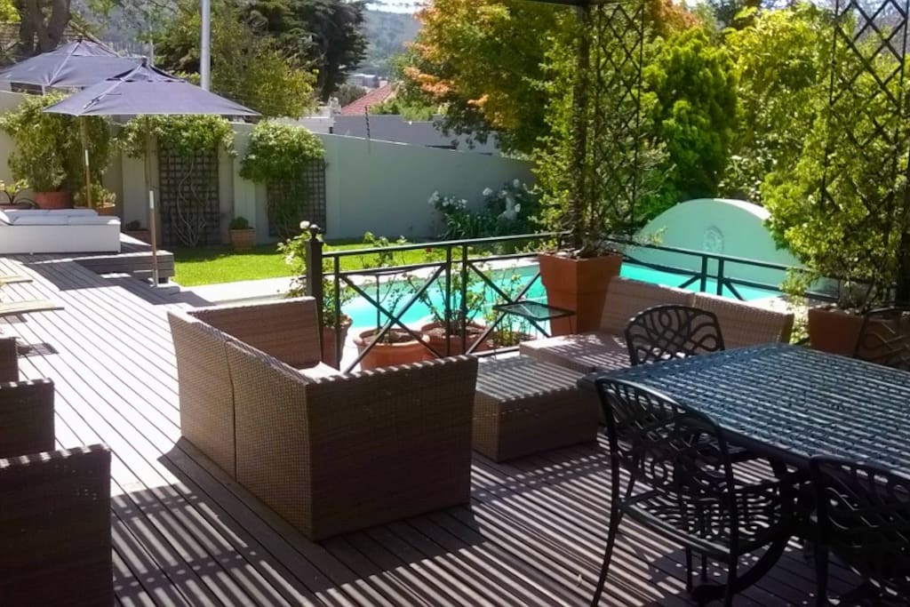 Shaded patio overlooking pool and garden.