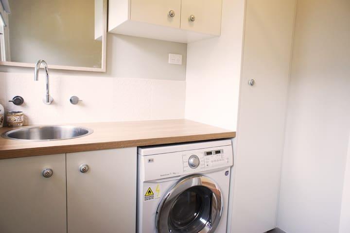 Laundry with plenty of storage, washer dryer combo