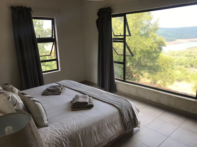 Stunning dam view from the bedroom.