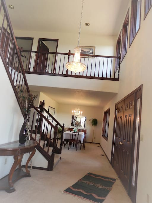 Private entrance door on the right. Guest room and bath doors upstairs  open on balcony.