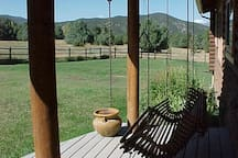 Sit on a porch swing gazing at the beautiful Sangre de Cristo mountains