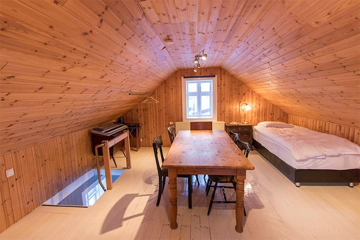 The attic, bedroom 3. A generous size table to work at with the rolling waves as a background sound.