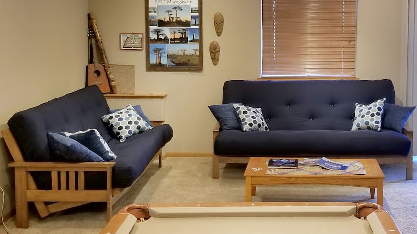 Comfortable seating in recreation room. Both futons can be converted to beds...one queen size and one full size. Please use appropriate bedding when sleeping on the futons.