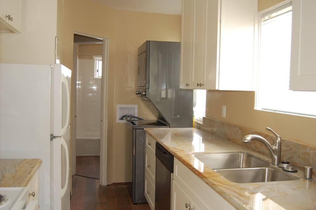 Newly upgraded kitchen with quartz counter tops, dishwasher, washer and dryer