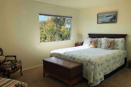 Relaxing California King Bedroom with Garden View