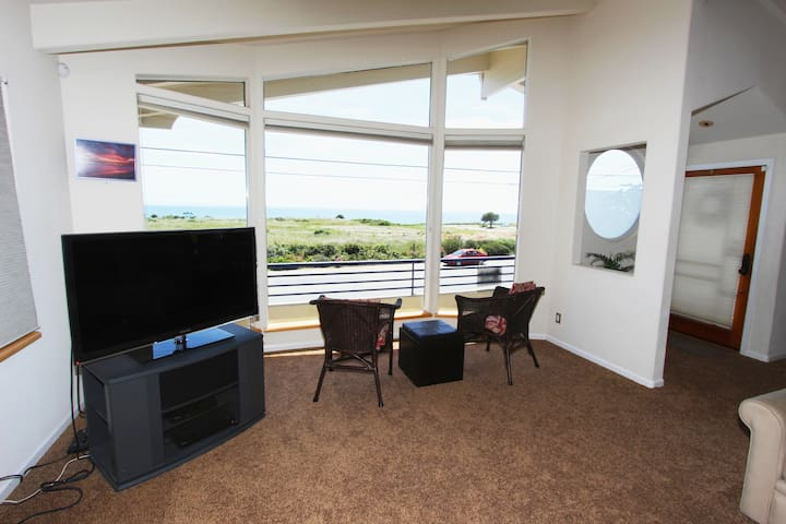 Relax and watch the world go by while gazing at the bay!