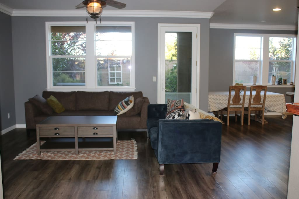 Living room with a kitchen dining table that seats 6-8 people