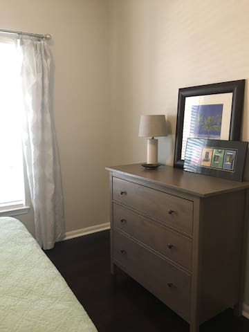 Dresser across from foot of bed for guest clothing and supplies. Chair has been added next to dresser (not in picture).