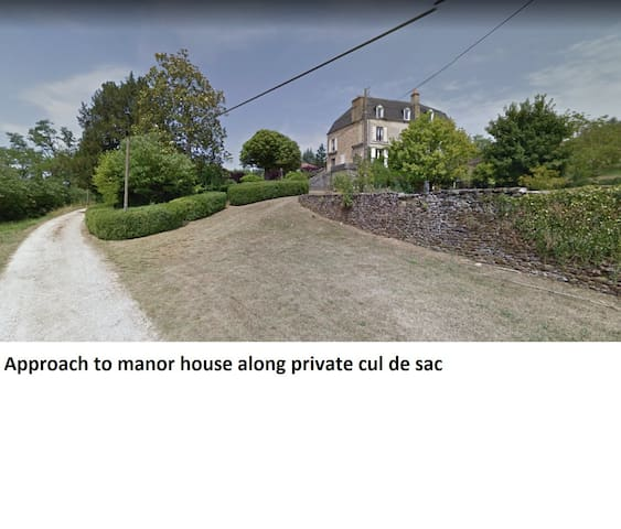 Approach to manor house along private cul de sac