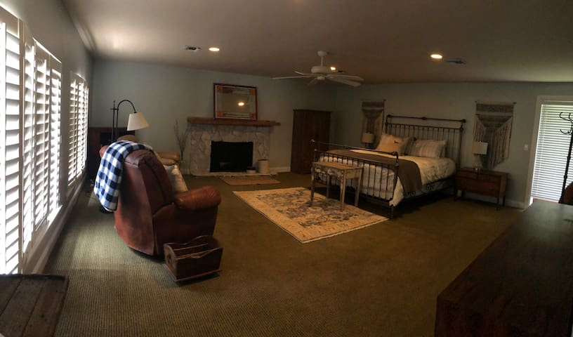 The master bedroom is massive!  Comfy king bed and recliners to relax and read.