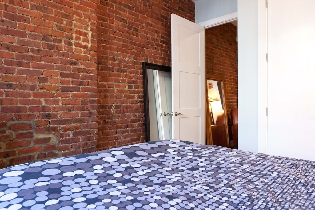 Here's the exposed brick wall in the bedroom and the door leading to the hallway