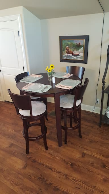 High kitchen table with seating for 4.