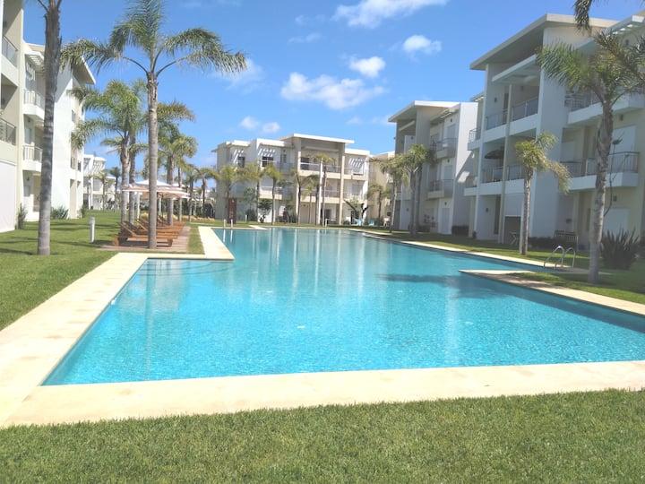 Appartement en bord de mer vue sur piscine