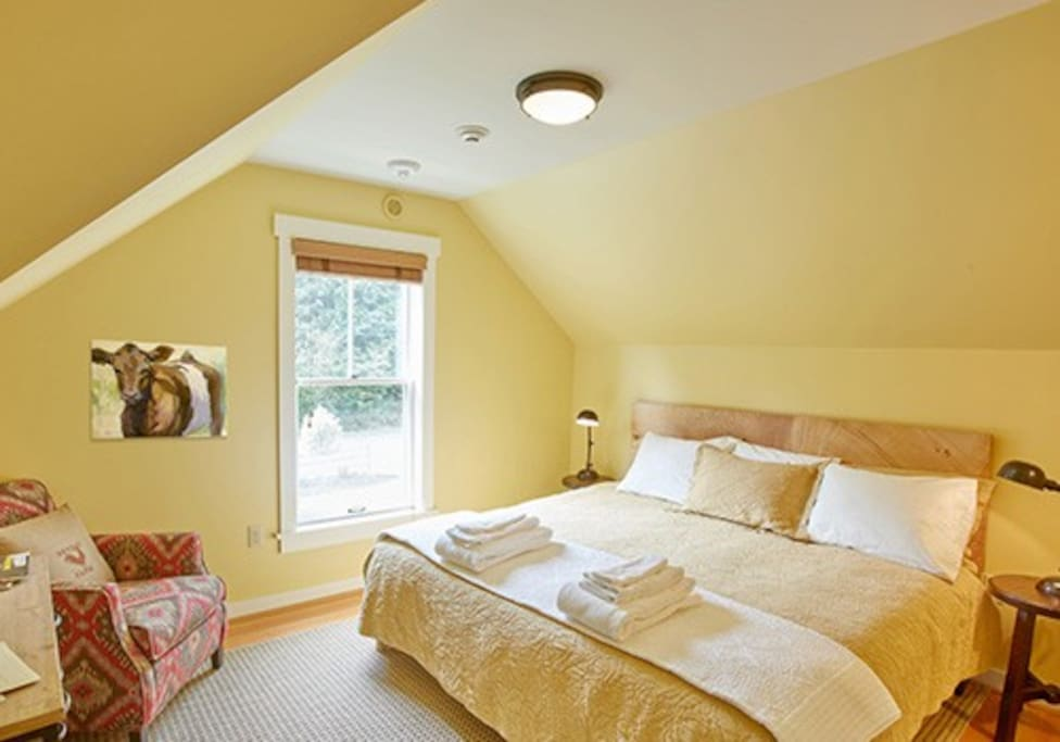 Room 2 has rustic furniture, an in-room wash basin and access to a hallway bath.