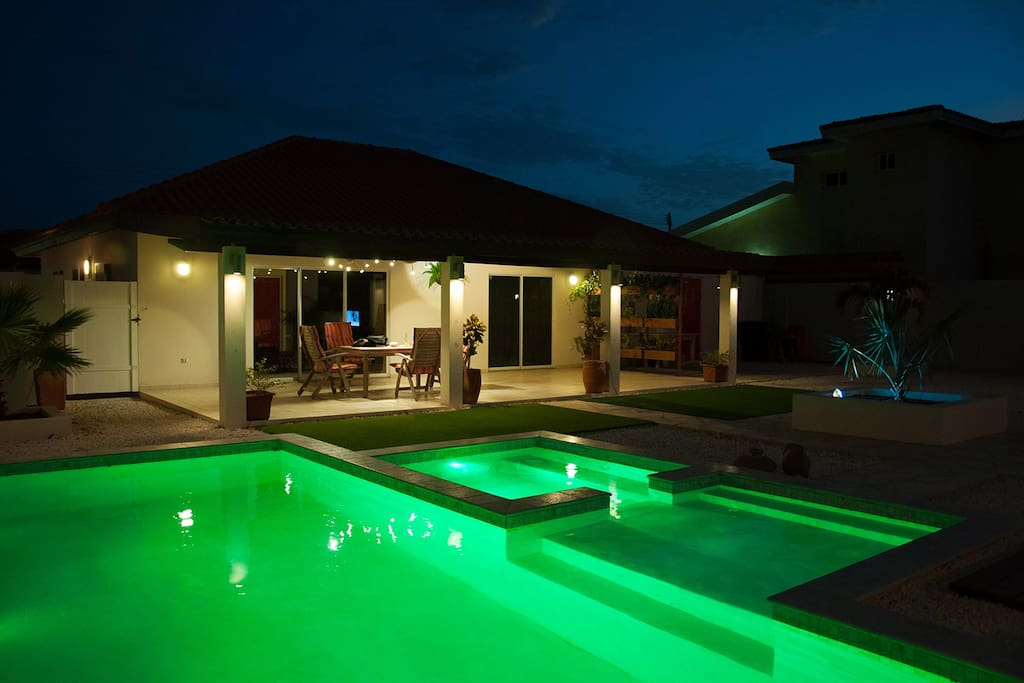 Pool and back porch at night.