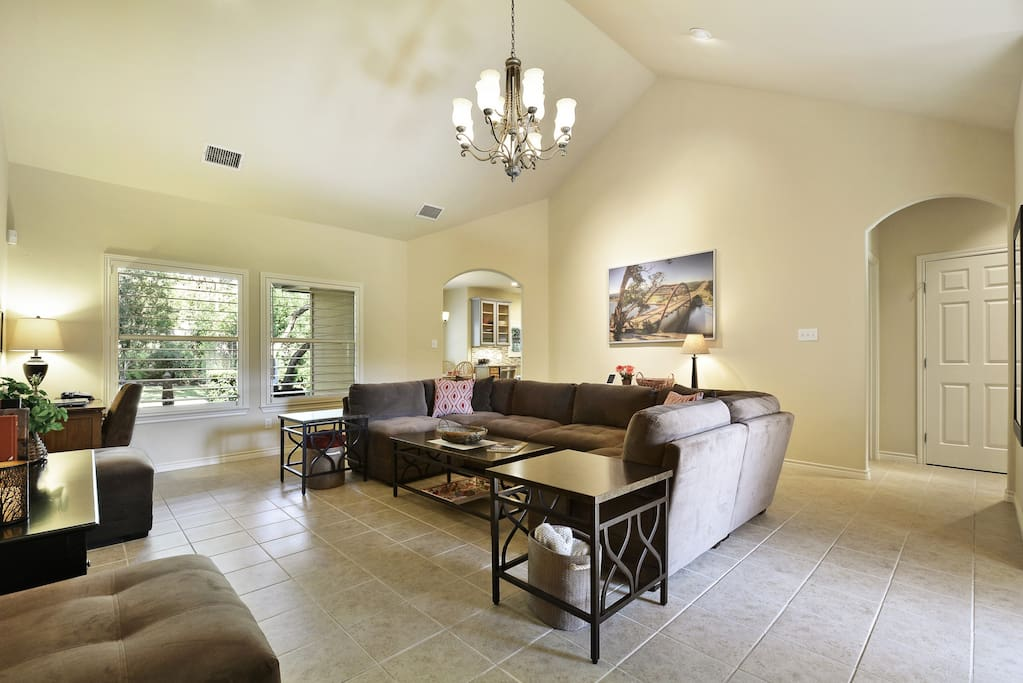 The spacious family room has cathedral ceilings and picture windows overlooking the lush yard.