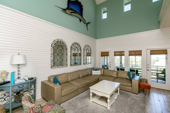 Large, open living area with amazing 30 ft vaulted ceiling.
