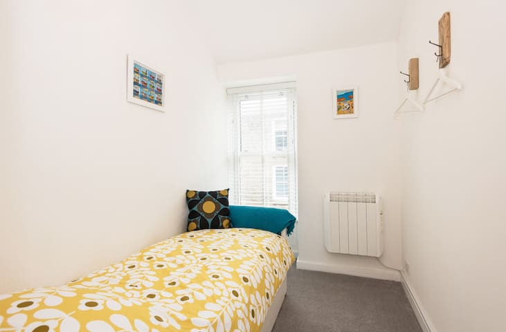 Smallest bedroom with single bed which pulls out to make twin if required