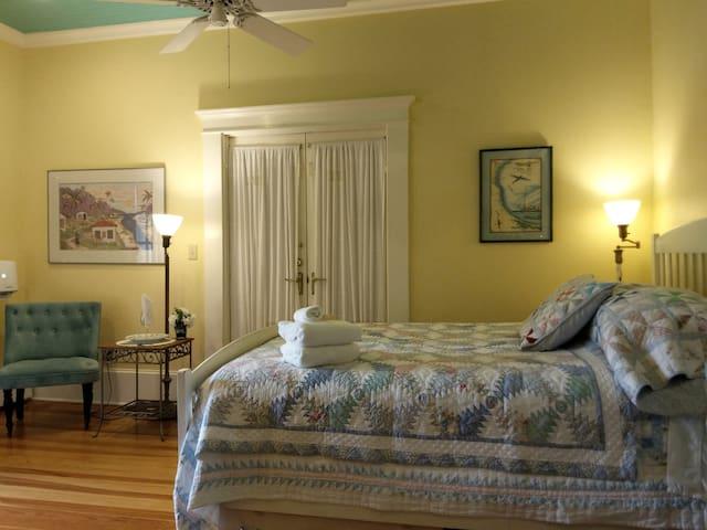 Queen bed & Original pine floors give the Caribbean Room an Island flavor