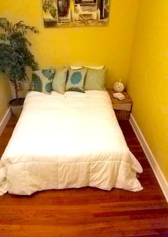 """Villa Tranquila's """"Guest Nest"""" Is a cozy little bedroom perfect for brief visits."""