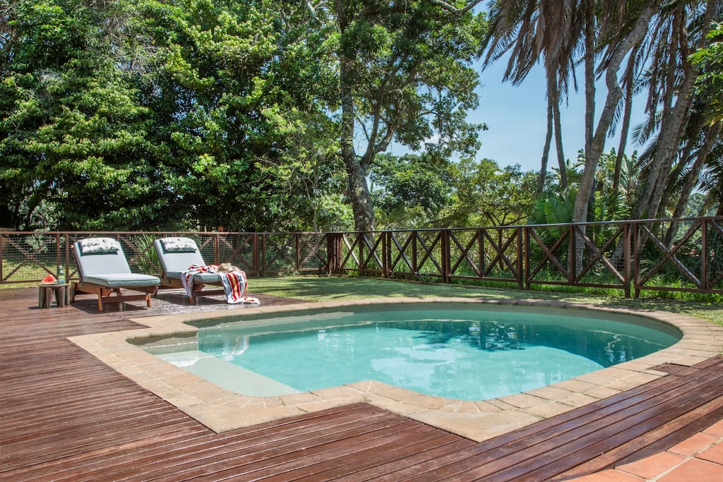 Enjoy the sunny tropical weather lazing around your own private swimming pool