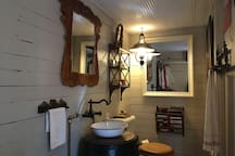The rustic powder room off the master completes the captains suite