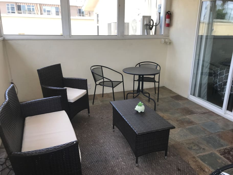 Private patio with a bistro table for coffee