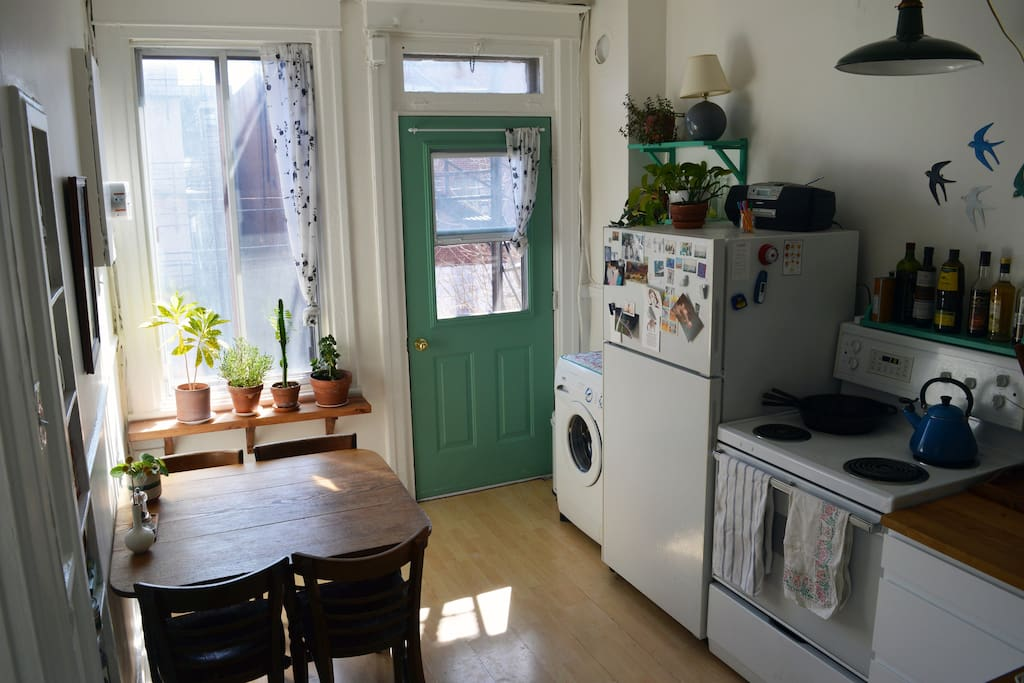 Sun-filled kitchen with a shared balcony