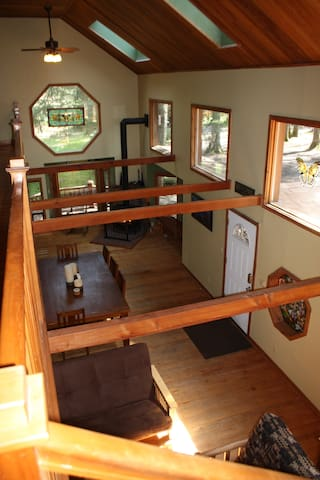A view of the open living/ dining area. Great for groups and families!