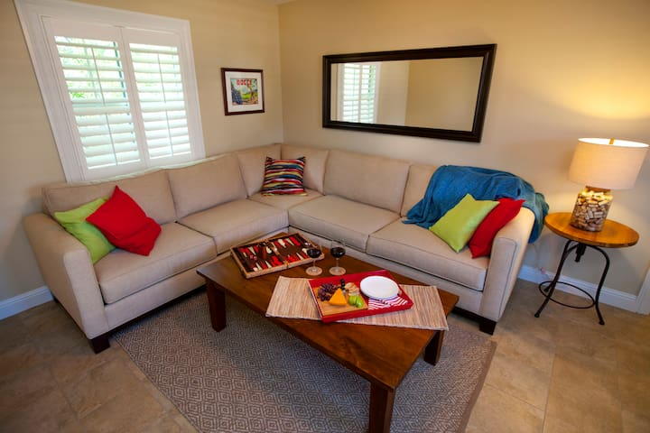 """The cozy Guest Cottage living room is a great second relaxation spot, or a nearby """"get away from the group"""" spot, with a 42-inch SMART TV."""