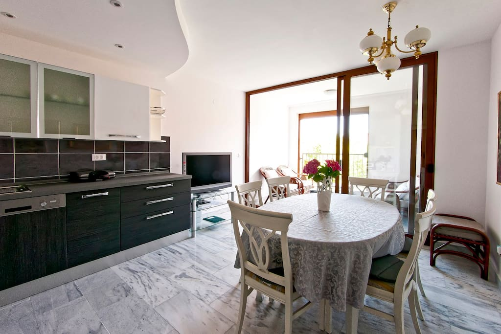 dining room and kitchen with loggia
