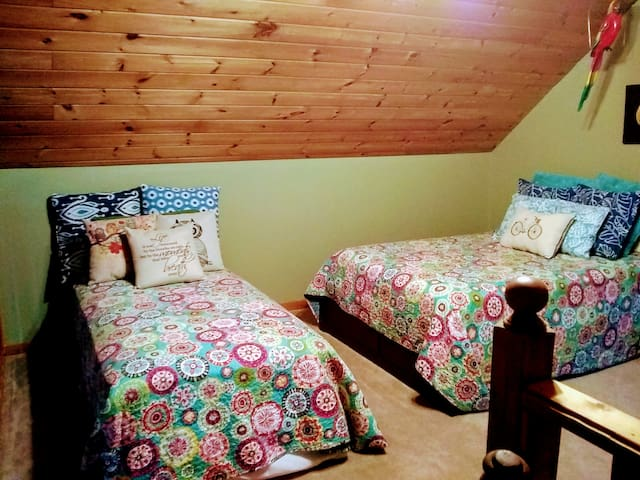 Loft/Game room area (3rd bedroom area) with queen and full size beds