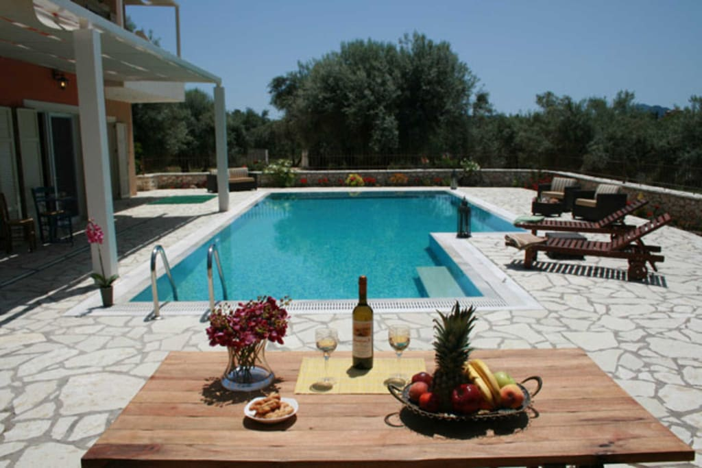 Dining area arround the pool at villa Niriides